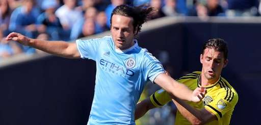 NYCFC midfielder Mix Diskerud moves the ball past