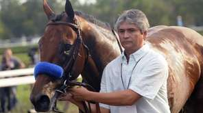 Triple Crown winner American Pharoah is led off
