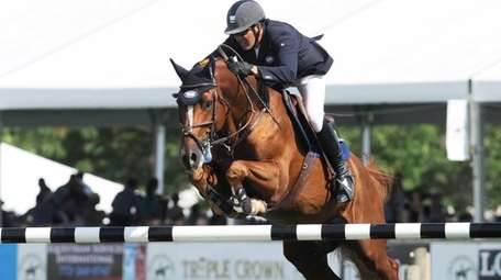 Paul O'Shea competes for the Longines Cup at