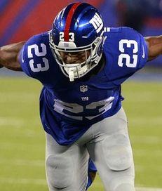 New York Giants running back Rashad Jennings slips