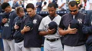 The New York Yankees' Alex Rodriguez, right, appears