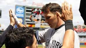 The New York Yankees' Stephen Drew, center, celebrates