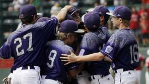 Pearland, Texas, players celebrate after winning the third-place