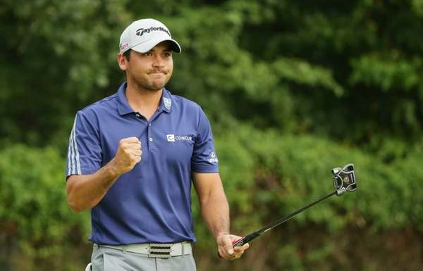 Jason Day celebrates a long birdie putt on
