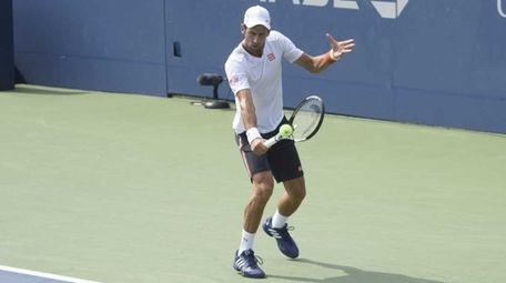 Tennis fans watch as Novak Jokovic practices at
