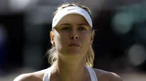 Maria Sharapova pauses during play against Serena Williams
