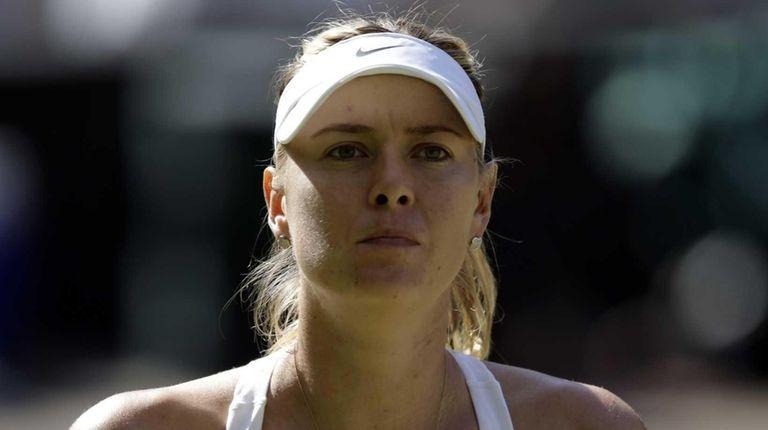 Maria Sharapova pauses during play against Serena Williams