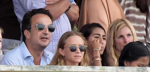 Olivier Sarkozy and Mary-Kate Olsen watch the 40th