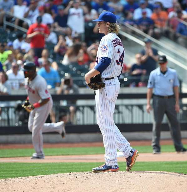 New York Mets starting pitcher Noah Syndergaard stands