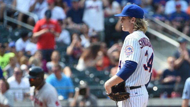 New York Mets starting pitcher Noah Syndergaard stands