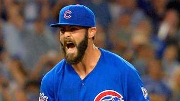 Chicago Cubs starting pitcher Jake Arrieta reacts after