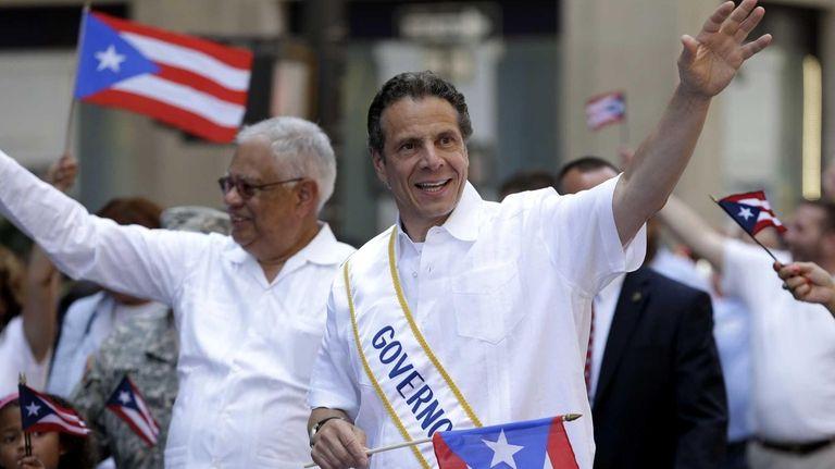 Gov. Andrew M. Cuomo walks in the Puerto