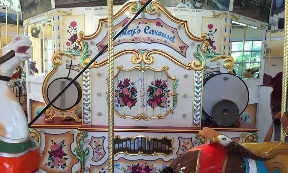 The carousel features an original Wurlitzer 153 band