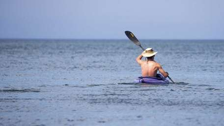 A man kayaks along the Long Island Sound
