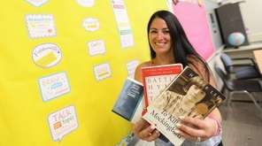 Ninth-grade English teacher Jennifer Bisulca holds up a