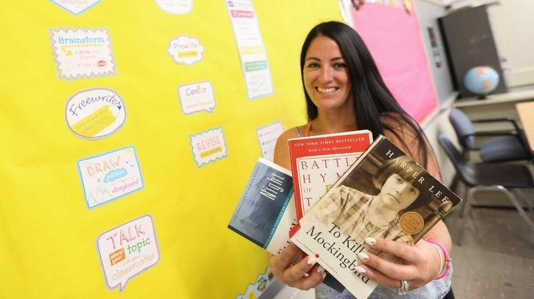 Ninth-grade English teacher Jennifer Bisulca holds up a