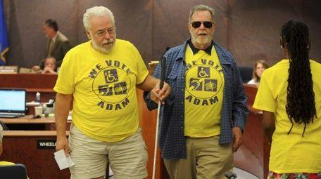 Bernard Ferracane, left, helps Victor Neisch, back to