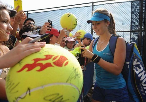 Belinda Bencic (SUI) signs autographs for fans outside