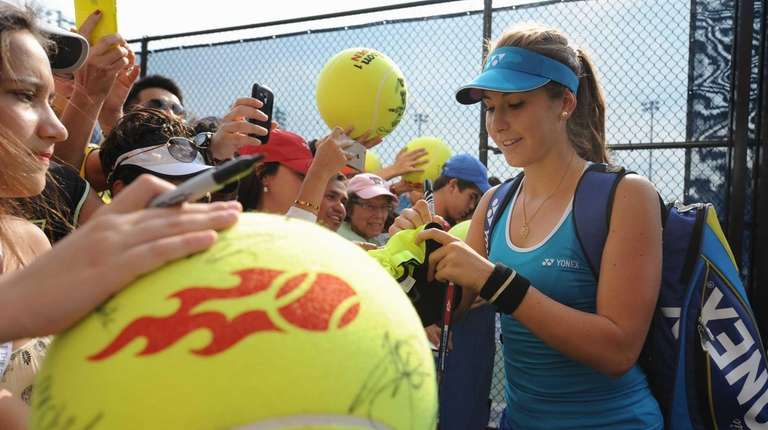 Belinda Bencic (SUI) signs autographs for fans outside