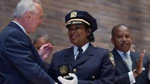 Police Commissioner William Bratton shakes hands with Kim