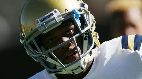 UCLA defensive back Ishmael Adams warms up before