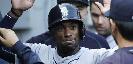 The Seattle Mariners' Austin Jackson celebrates with teammates