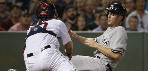 The New York Yankees' Greg Bird, right, slides