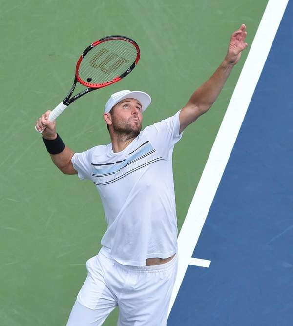 Mardy Fish serves during the first round of