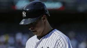 New York Yankees first baseman Mark Teixeira reacts