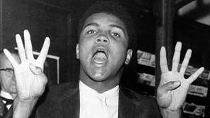 Muhammad Ali holds up eight fingers in London