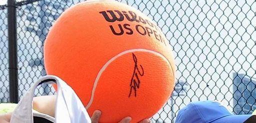 Belinda Bencic signs autographs for fans outside the