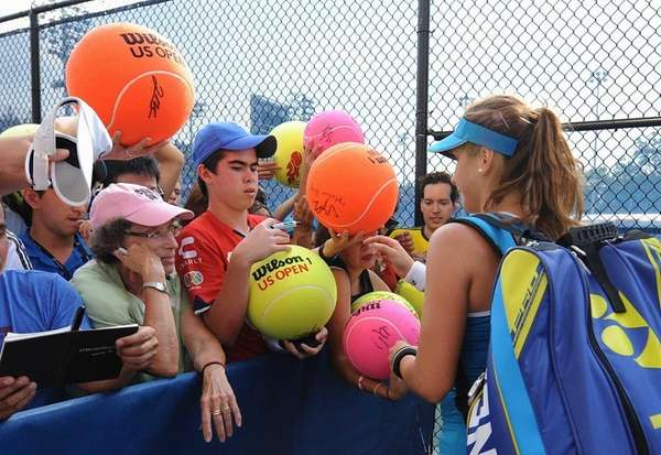 Belinda Bencic signs autographs for fans outside the