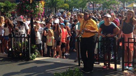 A crowd of fans waits for Roger Federer