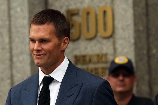 New England Patriots quarterback Tom Brady leaves federal