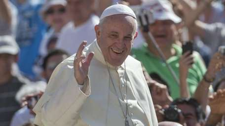 Pope Francis waves as he arrives for his