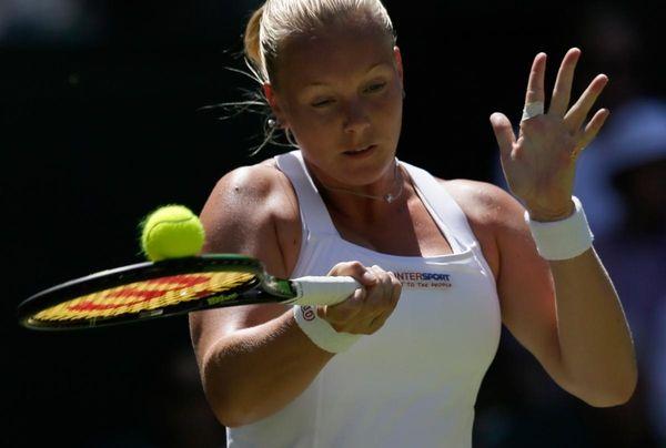 Kiki Bertens returns a ball to Petra Kvitova