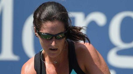 Jamie Loeb returns the ball to Caroline Wozniacki