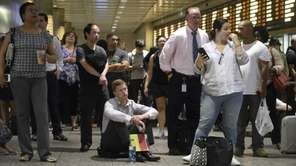 Passengers wait at Penn Station for Long Island