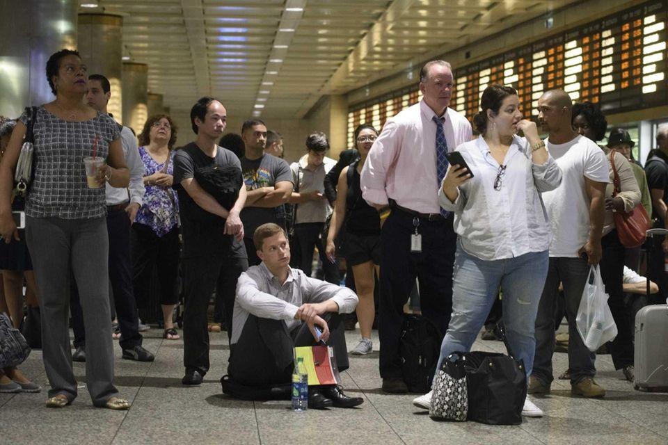 Passengers wait at Penn Station for Long Island