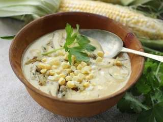 Corn chowder with sunflower seeds and onions.