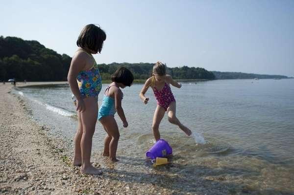 Children play at Beekman Beach in Oyster Bay