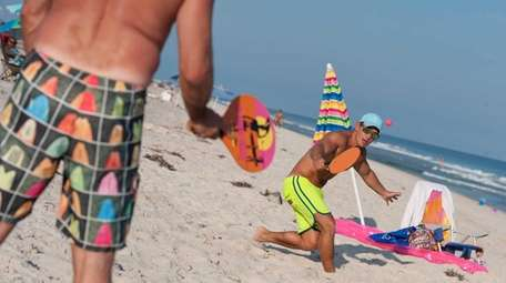 Hector Uribe of Manhattan plays paddleball with friends