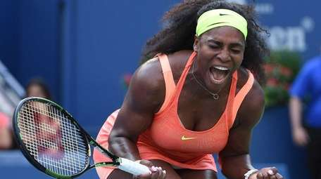 Serena Williams reacts after she wins the first