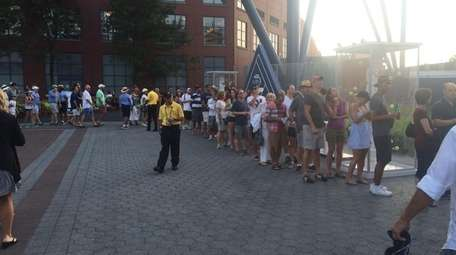 Fans wait in line to see Rafael Nadal