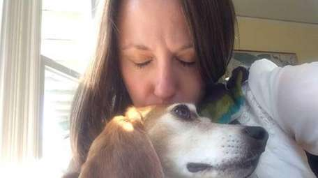 Melissa Andrews, of Maine, kisses her rescue dog