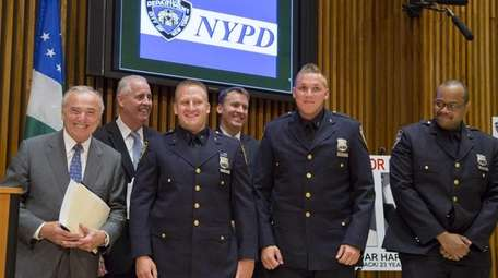 Police Commissioner William J. Bratton gives recognition to
