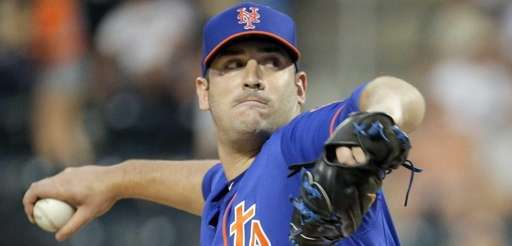 New York Mets starting pitcher Matt Harvey throws