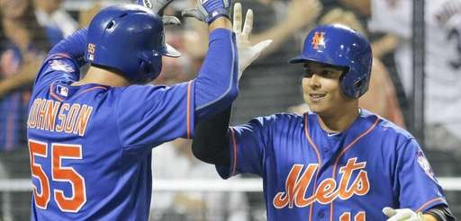 New York Mets shortstop Ruben Tejada celebrates with