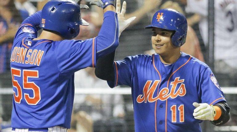 New York Mets shortstop Ruben Tejada celebrates with