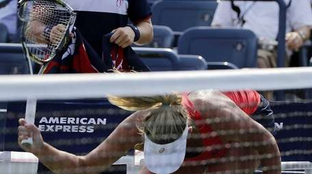 Coco Vandeweghe smashes her racket on the court